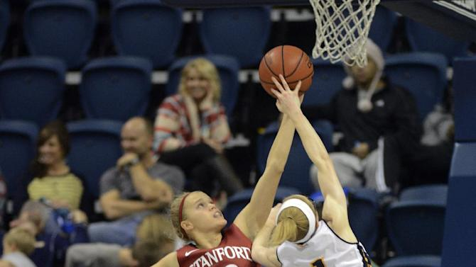 Chattanooga's Alicia Payne (1) shot is blocked by Stanford's Brittany McPhee (12) in the second half of an NCAA college basketball game Wednesday, Dec. 17, 2014, in Chattanooga, Tenn. Chattanooga won 54-46. (AP Photo/Billy Weeks)