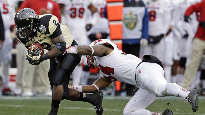 Vanderbilt running back Zac Stacy (2) is stopped by North Carolina State linebacker Rickey Dowdy (34) in the first quarter of the Music City Bowl NCAA college football game on Monday, Dec. 31, 2012, in Nashville, Tenn. (AP Photo/Mark Humphrey)