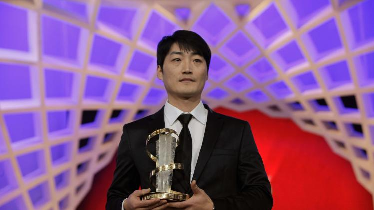 "Director Lee holds his Golden star award, which he won for his movie ""Han Gong-Ju"", at the 13th edition of the International Film Festival of Marrakech"