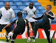 Jose Mourinho (right) attends a Chelsea training session at Stamford Bridge in 2007. Mourinho looks set to be welcomed back to Chelsea with open arms, but his reputation has been sullied during his three-year stint at Real Madrid and he will return to Stamford Bridge with several thorny issues to address