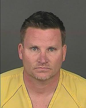 FILE - This undated file photo provided by the Denver Police Department shows Richard Kirk, 48. On Friday, Aug. 22, 2014, a preliminary hearing is scheduled for Kirk, who is charged with first-degree murder in the April 14 killing of his 44-year-old wife, Kristine Kirk, in their Denver home. Police officers arrived just after Kristine Kirk was shot in the head, about 15 minutes after she called 911. Police are investigating whether marijuana played a role in the killing. (AP Photo/Denver Police Department, File)