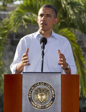 President Barack Obama speaks during a joint news conference with Colombian President Juan Manuel Santos during the 6th Summit of the Americas in Cartagena, Colombia, Sunday, April 15, 2012. (AP Photo/Carolyn Kaster)