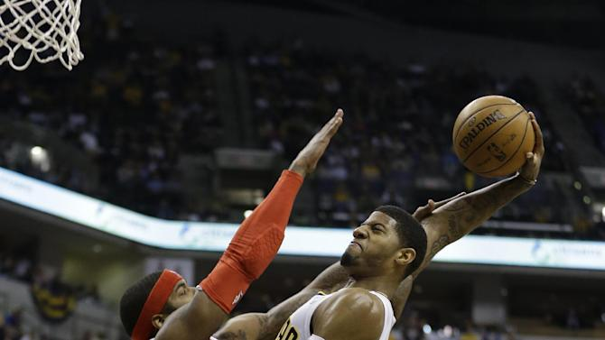 Indiana Pacers' Paul George, right, goes up for a dunk against Atlanta Hawks' Josh Smith (5) during the second half of Game 5 in the first round of the NBA basketball playoff series on Wednesday, May 1, 2013, in Indianapolis.  (AP Photo/Darron Cummings)
