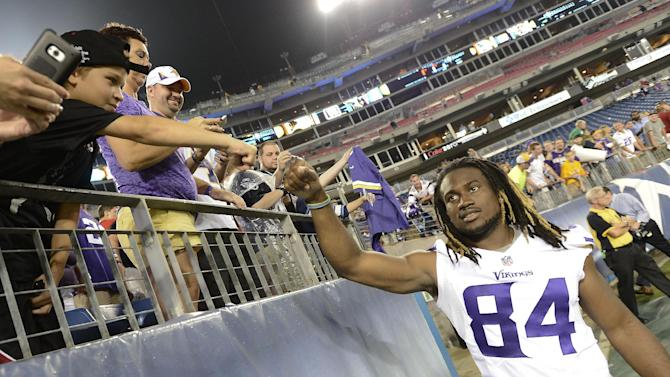 Minnesota Vikings wide receiver Cordarrelle Patterson (84) greets fans after the Vikings beat the Tennessee Titans 19-3 in a preseason NFL football game Thursday, Aug. 28, 2014, in Nashville, Tenn