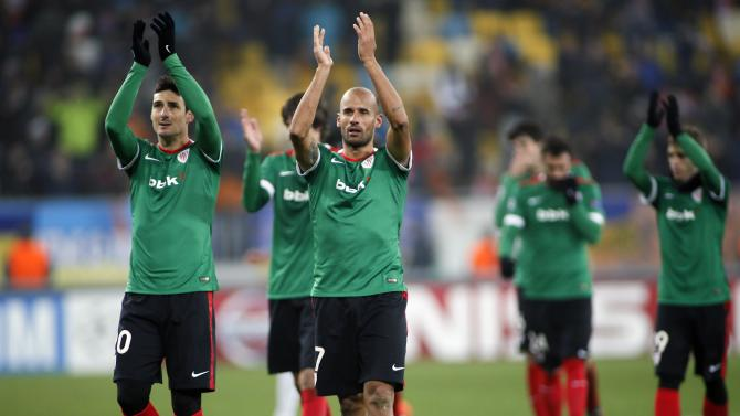 Athletic Bilbao's players greet supporters after winning against Shakhtar Donetsk during their Champions League Group match in Lviv