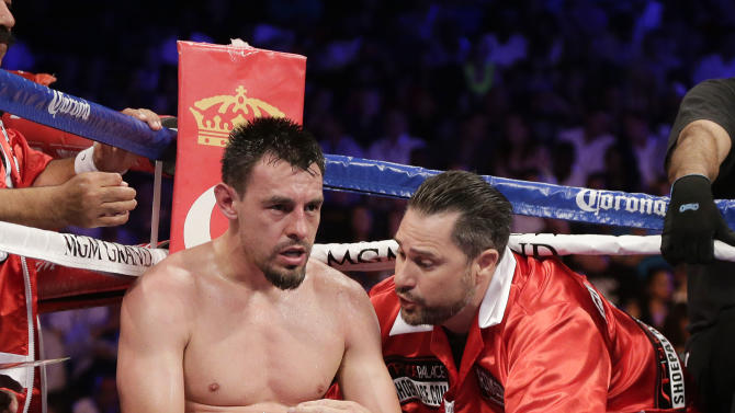 Robert Guerrero sits in his corner after the fifth round against Floyd Mayweather Jr. during a WBC welterweight title fight, Saturday, May 4, 2013, in Las Vegas. (AP Photo/Rick Bowmer)