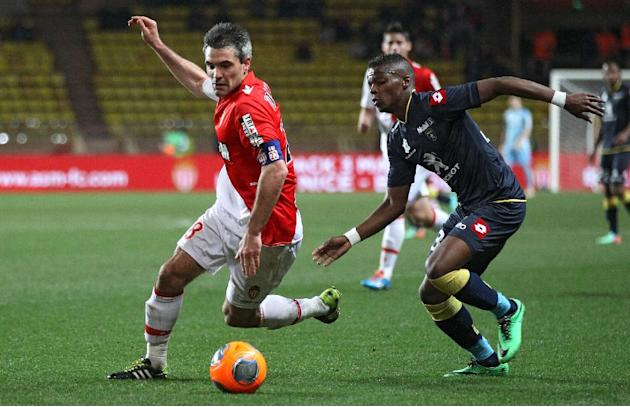 Monaco's Jeremy Toulalan of France, left, challenges for the ball with Sochaux player Mickael Malsa of France during their French League One soccer match, in Monaco stadium, Saturday March 8, 2014