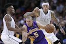 Miami Heat's Norris Cole defends against Los Angeles Lakers' Steve Blake in the first half of their NBA basketball game in Miami, Florida