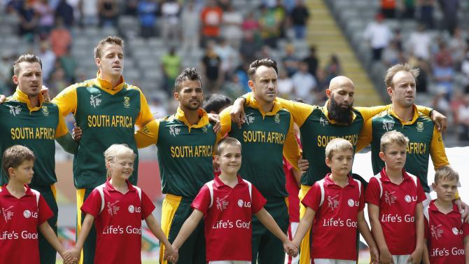 The South African team sings their national anthem before their Cricket World Cup match against Pakistan