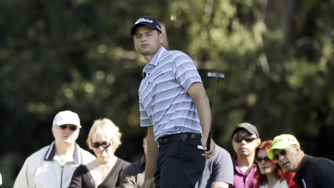 John Merrick misses an eagle putt but makes birdie on the first green watches in the final round of the Northern Trust Open golf tournament at Riviera Country Club in the Pacific Palisades area of Los Angeles, Sunday, Feb. 17, 2013. (AP Photo/Reed Saxon)