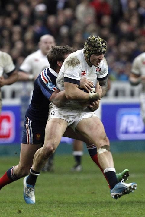 England's Jack Nowell is tackled by France's Maxime Medard, during their Six Nations rugby union international match, at the Stade de France, in Saint Denis, outside Paris, Saturday, Feb 1, 20