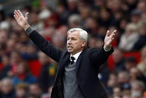 Newcastle United manager Pardew reacts during their English Premier League soccer match against Manchester United at Old Trafford in Manchester
