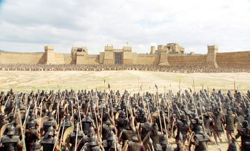 The Greek Armies face the impenetrable city wall in Warner Brothers' Troy