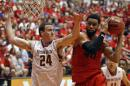 Dayton forward Devon Scott, right, goes to the basket against Boston College center Dennis Clifford during a NCAA college basketball game in San Juan, Puerto Rico, Sunday, Nov. 23, 2014. (AP Photo/Ricardo Arduengo)