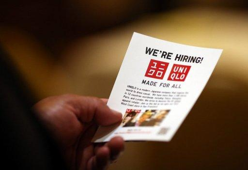 A job seeker holds a flier before meeting with a recruiter during a HIREvent job fair