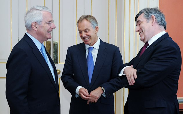 Former British Prime Ministers Sir John Major, left, Tony Blair, centre, and Gordon Brown chat before posing for a photograph with the Queen and Prime Minister David Cameron, ahead of a Diamond Jubilee lunch hosted by Cameron at 10 Downing Street, London Tuesday July 24, 2012. (AP Photo/Stefan Rousseau/Pool)