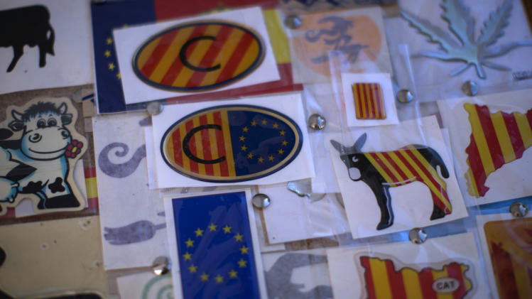 "In this photo taken on Saturday, Nov. 10, 2012, stickers with European Union and Catalan flags are seen for sale at street stall in Vic, a town declared by the city council a ""free Catalan territory"" in Spain. Catalonia holds elections on Sunday that will be seen as a test of the regional government's plans to hold a referendum on independence, and one of the key issues emerging is the theoretical place of a free Catalonia in Europe. (AP Photo/Emilio Morenatti)"
