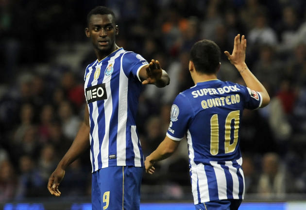 FC Porto's Colombians Jackson Martinez, left, and Juan Quintero celebrate after scoring their team's fourth goal against Arouca in a Portuguese League soccer match at the Dragao stadium, in Po