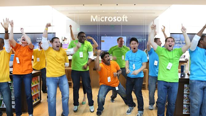 COMMERCIAL IMAGE - In this photograph taken by AP Images for Microsoft, Microsoft store employees jump with excitement as the curtain drops at the new Microsoft Store at The Shops at Prudential Center on Thursday, Aug. 23, 2012 in Boston. (Bizuayehu Tesfaye/AP Images for Microsoft)