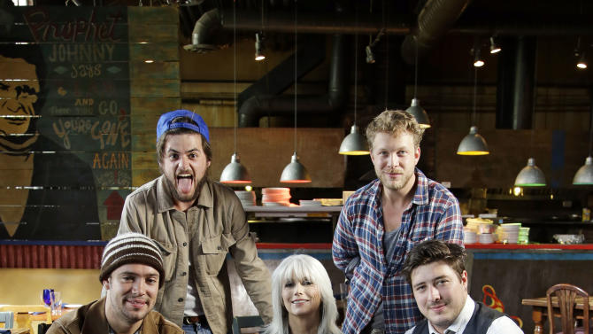 """This Sept. 5, 2012 photo shows the band Mumford and Sons with Emmylou Harris, from left, Ben Lovett, Winston Marshall, Emmylou Harris, Ted Dwane and Marcus Mumford, in Franklin, Tenn. Harris, an iconic singer and member of the Country Music Hall of Fame, and Mumford & Sons, platinum-selling lads from London who have sparked a folk rock resurgence, are joining together to explore their shared love of high harmony, sad songs and, yes, the oft-belittled banjo on an episode of """"CMT Crossroads"""" on Thursday, Sept. 27.  (AP Photo/Mark Humphrey)"""