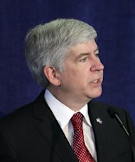 FILE - In this April 27, 2011 file photo, Michigan Gov. Rick Snyder delivers an address at a United Way office in Detroit on changes he wants to see in education. On Tuesday, Sept. 6, 2011, Snyder signed legislation creating a four-year lifetime limit for people to receive cash welfare assistance in Michigan. The measure is expected to force 41,000 people off the welfare rolls on Oct. 1, when the next state fiscal year begins. (AP Photo/Carlos Osorio, File)