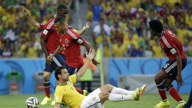 Brazil's Fred protests after being fouled during the World Cup quarterfinal soccer match between Brazil and Colombia at the Arena Castelao in Fortaleza, Brazil, Friday, July 4, 2014. (AP Photo/Hassan Ammar)