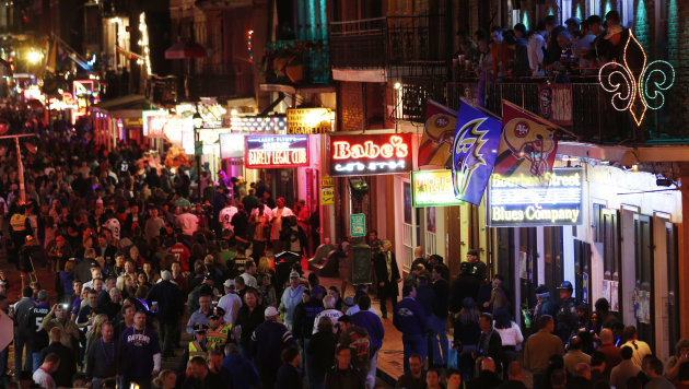 People walk along Bourbon Street in downtown New Orleans, as revelers gathered in the city&#39;s French Quarter, Friday, Feb. 1, 2013. The city kicked off NFL football Super Bowl weekend as it awaits for Sunday&#39;s game between the San Francisco 49ers and the Baltimore Ravens at the Superdome. (AP Photo/Julio Cortez)