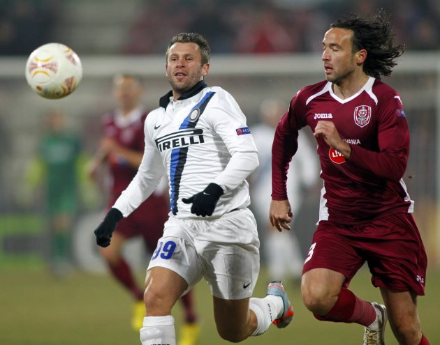 Inter Milan's Cassano challenges CFR Cluj's Piccolo during their Europa League soccer match in Cluj-Napoca