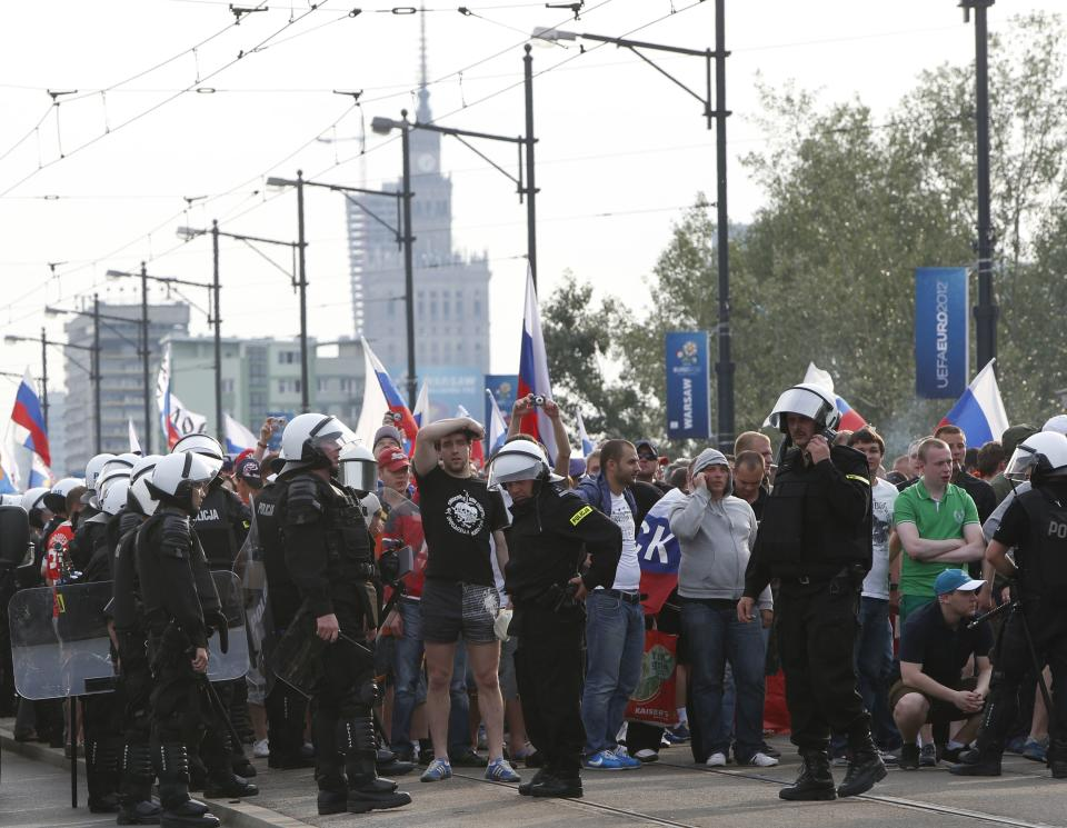 Polish police block a bridge outside the stadium where the Euro 2012 soccer championship group A match between Poland and Russia is to be played in Warsaw, Poland , Tuesday, June 12, 2012. (AP Photo/Czarek Sokolowski)