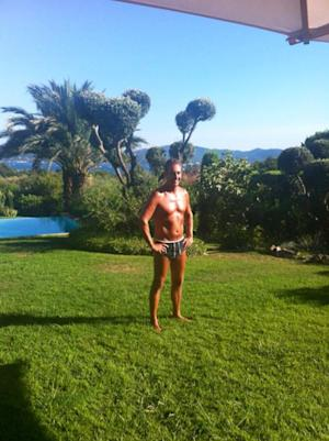 In this undated photo provided by the Austrian Freedom Party (FPOE) via Facebook, the party's head Heinz-Christian Strache poses in his bathing suit at an unknown location. As the campaign for Austrian general elections enters its grueling final phase, two high-profile contenders have gone beyond rolling up their shirt sleeves: They've taken off their shirts. Posing bare-chested is the newest twist on the rivalry between populist candidate Frank Stronach and Heinz-Christian Strache, who heads the anti-immigrant and EU-skeptic Freedom Party, as the two compete for the protest vote ahead of the Sept. 29 elections. (AP Photo/Austrian Freedom Party via Facebook)