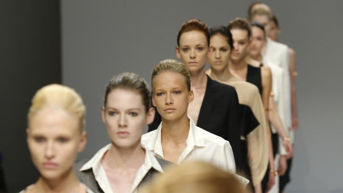 Models walk at the end of Veronique Branquinho's Spring Summer 2013 ready to wear collection, presented in Paris, Tuesday, Sept.25, 2012. (AP Photo/Jacques Brinon)