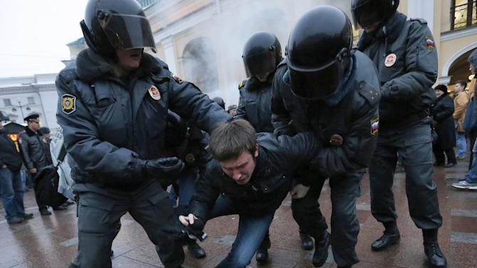 FILE - This Oct. 31, 2012, file photo, shows police officers detaining an opposition activist during an unsanctioned protest rally in St. Petersburg, Russia. Tensions between the U.S. and Russia have been rising. The countries have been at odds over Syria's civil war, Iran's nuclear program and Russia's crackdown on domestic opposition. U.S. officials are uneasy about what they see as a more assertive foreign policy by Vladimir Putin, who returned to the Russian presidency in May. (AP Photo/Dmitry Lovetsky, File)