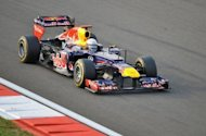 Red Bull-Renault driver Sebastian Vettel of Germany drives his car during the Formula One Korean Grand Prix at the Korean Circuit in Yeongam on October 14, 2012. A peerless Vettel leapfrogged Fernando Alonso at the top of the world championship on Sunday as the Red Bull driver led from the first corner to win