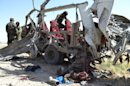 Pakistani security personnel examine a vehicle following a bombing in Quetta, Pakistan on Thursday, May 23, 2013. A car bomb targeting a police vehicle killed 11 policemen and one civilian Thursday in an area of southwest Pakistan wracked by a separatist insurgency and Islamic militancy, police said. (AP Photo/Arshad Butt)