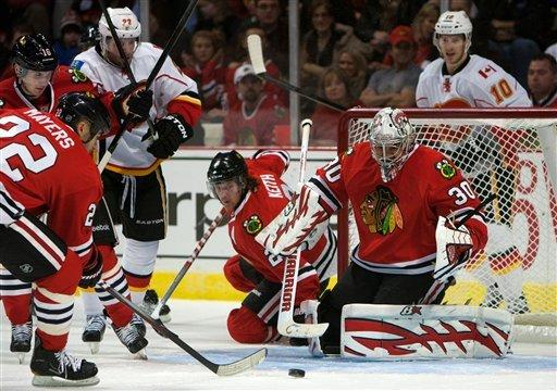 Hossa has goal, assist in Hawks' win over Flames