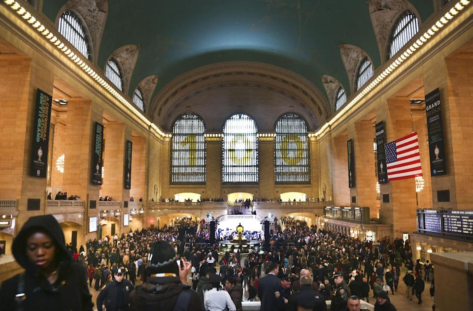 Crowds gather as Grand Central Terminal kicks off its centennial celebration on Friday, Feb. 1, 2013 in New York. New Yorkers are celebrating the 100th birthday of Grand Central terminal with music, speeches and a cake shaped like the main concourse's famous clock. (AP Photo/Bebeto Matthews)