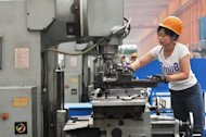 A worker operates a machine at a factory in Binzhou, northeast China's Shandong province, on June 5. China's manufacturing activity hit a seven-month low in June as shrinking exports and weak domestic demand shook the world's second largest economy, according to British bank HSBC