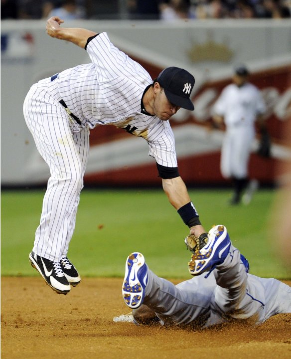 Los Angeles Dodgers' Puig steals second base as New York Yankees' Nix applies the late tag during a MLB inter-league baseball game double-header in New York