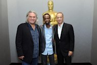 "Paul Greengrass, Barkhad Abdi and Tom Hanks attend the Academy of Motion Picture Arts and Sciences official Academy members screening of ""Captain Phillips,"" in New York, on October 7, 2013"