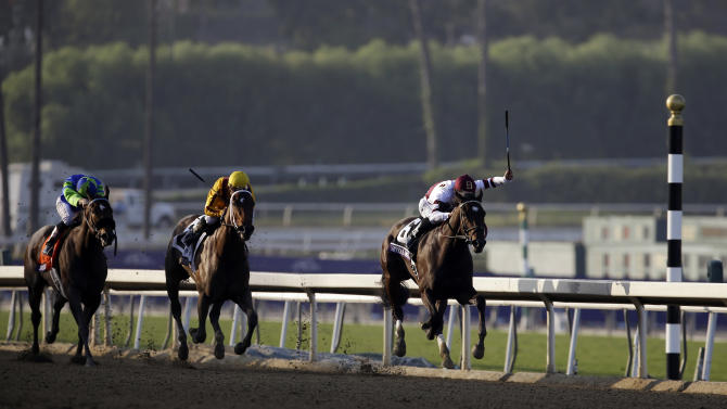 Royal Delta, right, ridden by Mike Smith, leads My Miss Aurelia, center, ridden by Corey Nakatani, and Include Me Out, left, ridden by Joseph Talamo, down the stretch to win the Breeders' Cup Ladies' Classic horse race, Friday, Nov. 2, 2012, Arcadia, Calif. (AP Photo/Julie Jacobson)
