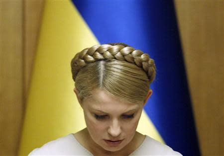 File photo of Ukraine's then Prime Minister and presidential candidate Yulia Tymoshenko chairing a cabinet meeting in Kiev