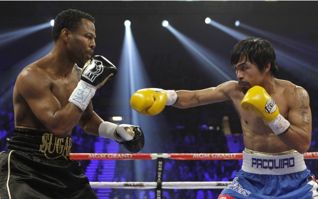 Shane Mosley, left, and Manny Pacquiao exchange punches in the second round during a WBO welterweight title bout, Saturday, May 7, 2011, in Las Vegas.  (AP Photo/Isaac Brekken)