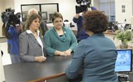 Cindy Bovee-Kemper (L) and Lisa Bovee-Kemper apply for a marriage license they knew they would be denied as part of the &quot;We Do Campaign&quot; in Winston-Salem, North Carolina, January 14, 2013. REUTERS/Colleen Jenkins/Files