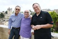 R-L: US wine critic and oenologist, Robert Parker, producer Tommy Lipuma and the founder of the Saint-Emilion jazz festival Dominique Renard pose on July 19 in Saint-Emilion, western France