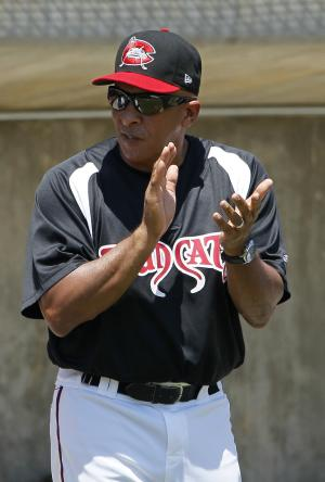 In this photo taken Wednesday, June 27, 2012, Carolina Mudcats manager Edwin Rodriguez coaches his team during a minor league baseball game against the Frederick Keys in Zebulon, N.C. Rodriguez is a former manager of the Miami Marlins. (AP Photo/Gerry Broome)