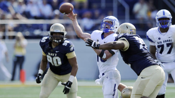 Air Force quarterback Karson Roberts, center, is pressured by Navy linebacker DJ Sargenti, bottom right, and Travis Bridges, top right, during the second half of an NCAA football game, Saturday, Oct. 5, 2013, in Annapolis, Md. Navy won 28-10. Also seen is Navy defensive end Will Anthony (90). (AP Photo/Nick Wass)