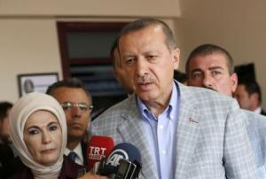 Prime Minister and presidential candidate Erdogan talks with media during presidential elections in Istanbul