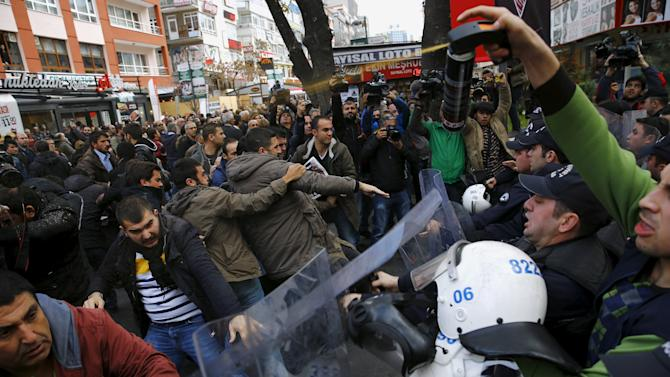 Police use tear-inducing agent against demonstrators during a protest over the arrest of journalists Can Dundar and Erdem Gul in Ankara