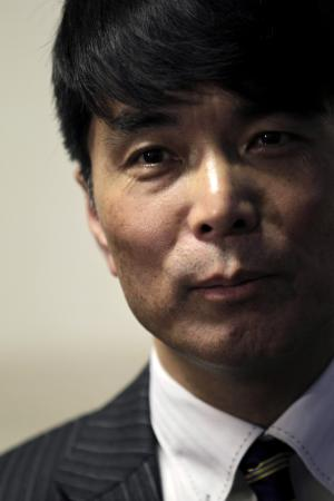 "Japanese journalist Yoji Gomi who published a book titled ""My father, Kim Jong Il, and Me"" pauses during an interview with The Associated Press in Tokyo Friday, Jan. 20, 2012. Gomi said late North Korean leader Kim Jong Il's eldest son Kim Jong Nam said his reclusive country now run by his inexperienced half-brother could fail without economic reforms. (AP Photo/Hiro Komae)"