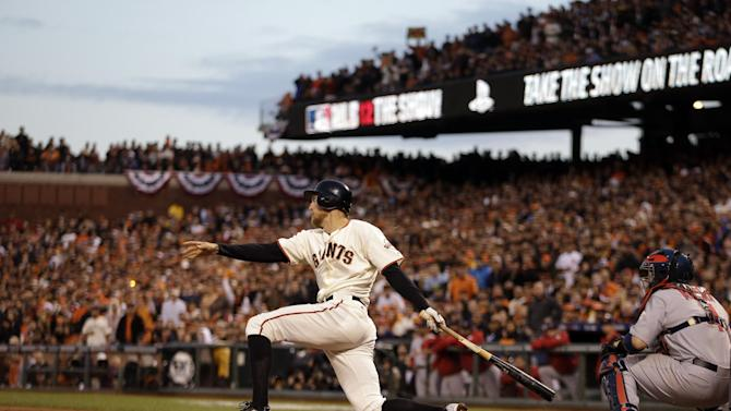 San Francisco Giants' Hunter Pence hits a three-run double during the third inning of Game 7 of baseball's National League championship series against the St. Louis Cardinals Monday, Oct. 22, 2012, in San Francisco. (AP Photo/Ben Margot)